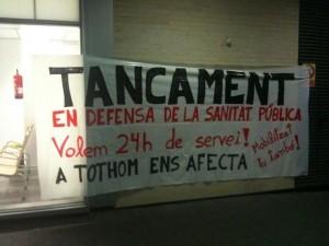 Pancarta en contra de les retallades // Molins contra les retallades
