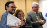 Els propietaris de Fotogenia amb el regidor de Comers Joaquim Martí // Jose Polo