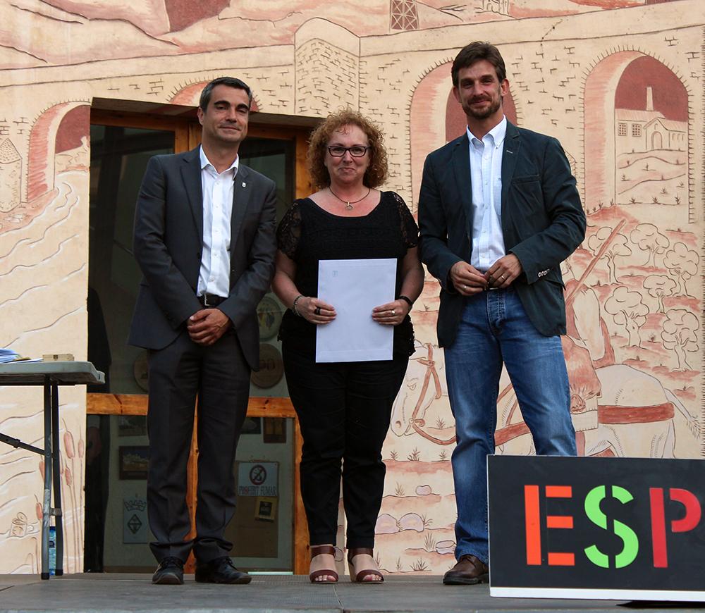 Carme Beltran recollint el premi // Jose Polo